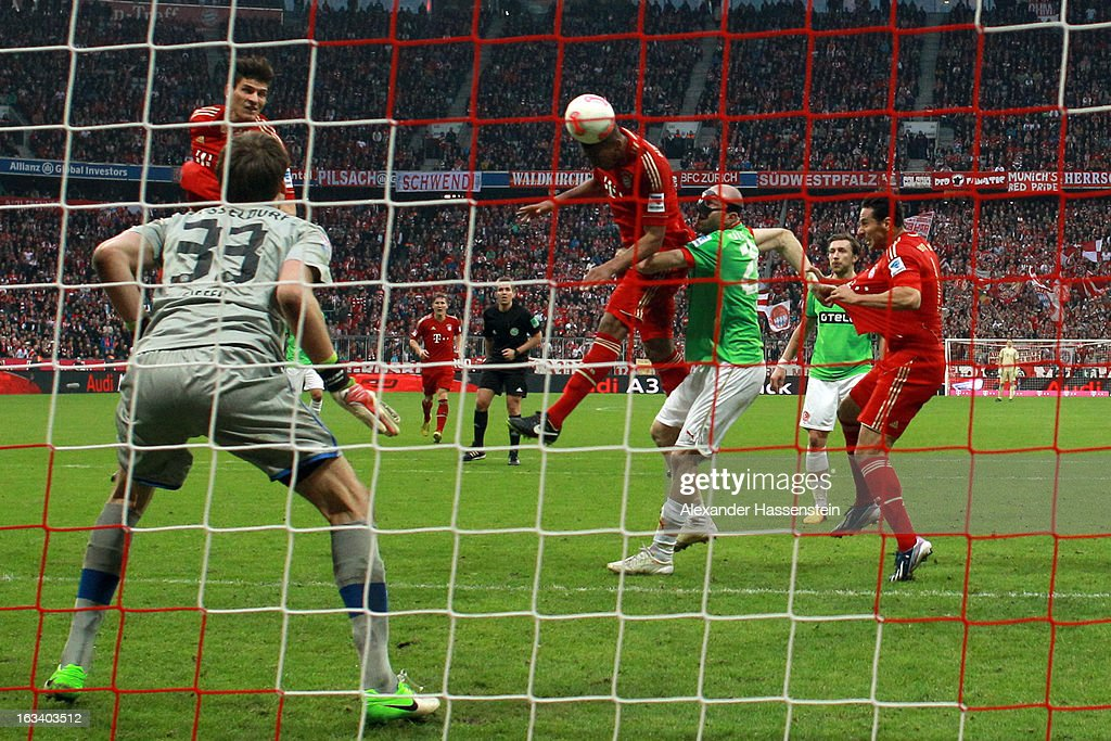 Jerome Boateng (3rd L) of Muenchen scores the winning goal during the Bundesliga match between FC Bayern Muenchen and Fortuna Duesseldorf 1895 at Allianz Arena on March 9, 2013 in Munich, Germany.