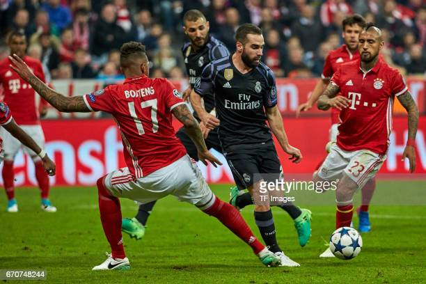 Jerome Boateng of Munich and Arturo Vidal of Munich and Daniel Carvajal of Real Madrid battle for the ball during the UEFA Champions League Quarter...