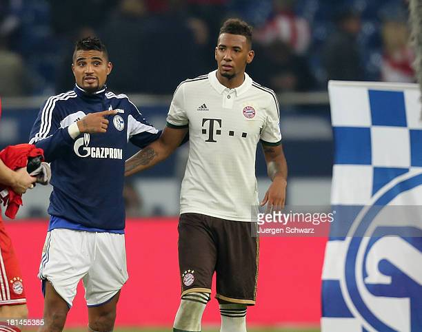Jerome Boateng of Munich hugs his brother KevinPrince Boateng of Schalke after the Bundesliga match between FC Schalke 04 and FC Bayern Muenchen at...