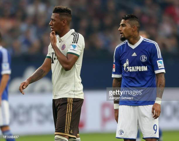 Jerome Boateng of Munich stands close to his brother KevinPrince Boateng of Schalke during the Bundesliga match between FC Schalke 04 and FC Bayern...