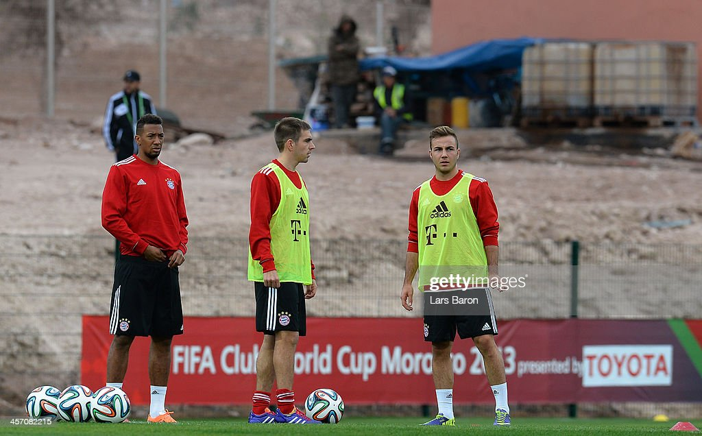 Jerome Boateng, Philipp Lahm and Mario Goetze are seen during a Bayern Muenchen training session for the FIFA Club World Cup next to Agadir Stadium on December 16, 2013 in Agadir, Morocco.