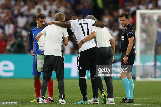 Jerome Boating of Germany is carried off during the UEFA Euro 2016 Semi Final match between Germany and France at Stade Velodrome on July 07 2016 in...