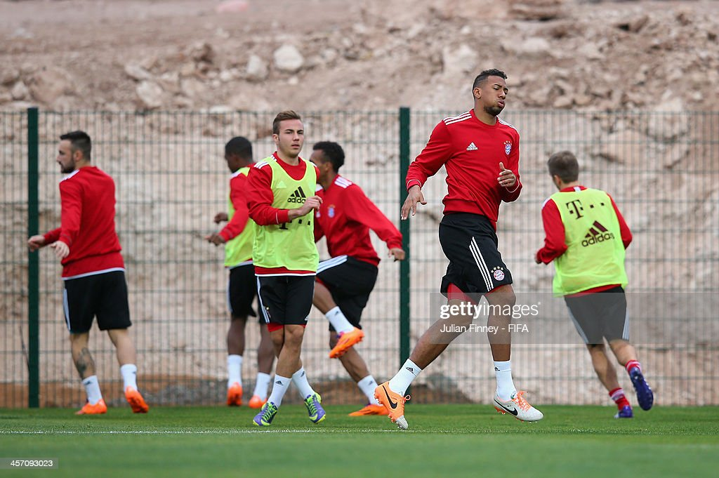 Jerome Boeteng and Mario Gotze of Bayern Muenchen warm up during a training session outside the Agadir Stadium on December 16, 2013 in Agadir, Morocco.