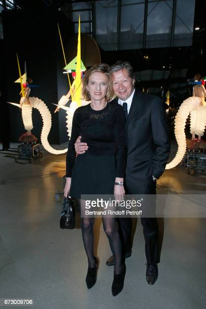 Jerome de Noirmont and his wife Emmanuelle pose in front the works of JeanPaul Goude during the 'Societe des Amis du Musee d'Art Moderne du Centre...