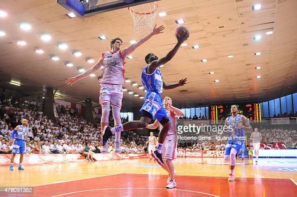 Jerome Dyson of Banco di Sardegna competes with Achille Polonara of Grissin Bon during match 1 of the final series of the Italian LegaBasket Serie A...