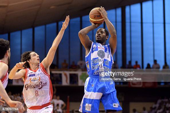 Jerome Dyson of Banco di Sardegna competes with Amedeo Della Valle of Grissin Bon during match 1 of the final series of the Italian LegaBasket Serie...