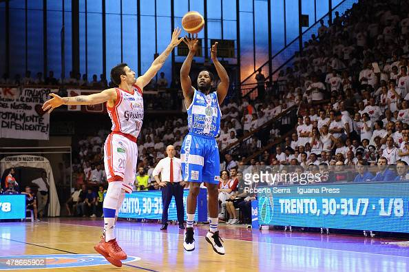 Jerome Dyson of Banco di Sardegna competes with Andrea Cinciarini of Grissin Bon during the match of LegaBasket Serie A playoff Final Game 7 between...