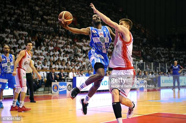 Jerome Dyson of Banco di Sardegna competes with Ojars Silins of Grissin Bon during match 1 of the final series of the Italian LegaBasket Serie A...