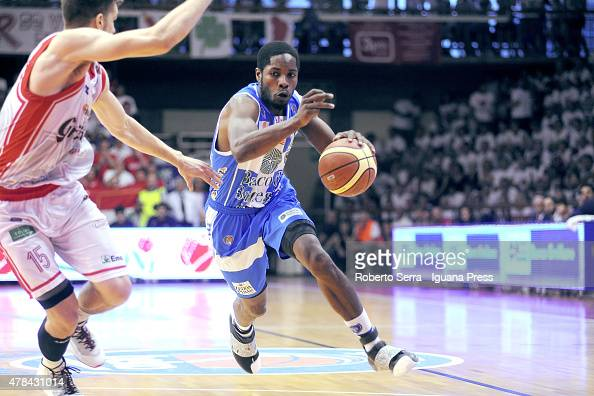 Jerome Dyson of Banco di Sardegna competes with Ojars Silins of Grissin Bon during the match between Grissin Bon Reggio Emilia and Banco di Sardegna...