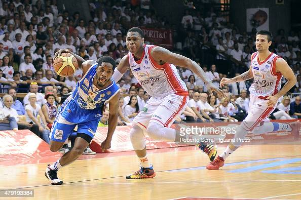 Jerome Dyson of Banco di Sardegna competes with Vitalis Chikoko of Grissin Bon during the match of LegaBasket Serie A game 7 of playoff's final...