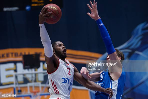 Jerome Dyson of Hapoel Jerusalem and Anton Pushkov of Zenit vie for the ball during the EuroCup Top 16 Round 2 basketball match between Zenit and...