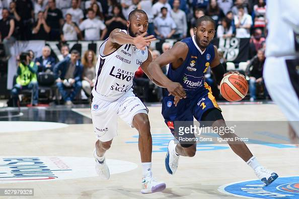 Jerome Dyson of Manital competes with Kenny Hasbrouck of Obiettivo Lavoro during the LegaBasket match between Virtus Obiettivo Lavoro Bologna v...