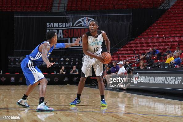 Jerome Dyson of the Charlotte Hornets handles the ball against the Golden State Warriors at the Samsung NBA Summer League 2014 on July 11 2014 at the...