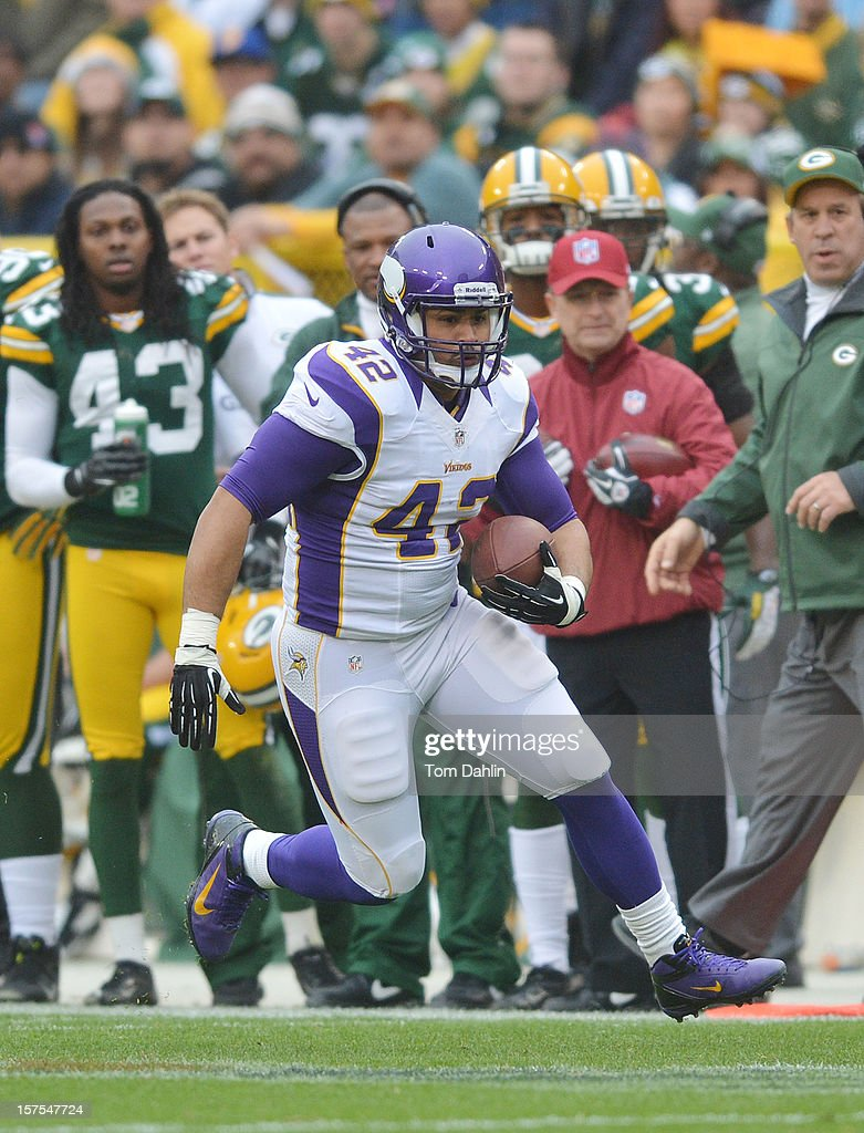 Jerome Felton #42 of the Minnesota Vikings carries the ball during an NFL game against the Green Bay Packers at Lambeau Field on December 2, 2012 in Green Bay, Wisconsin.