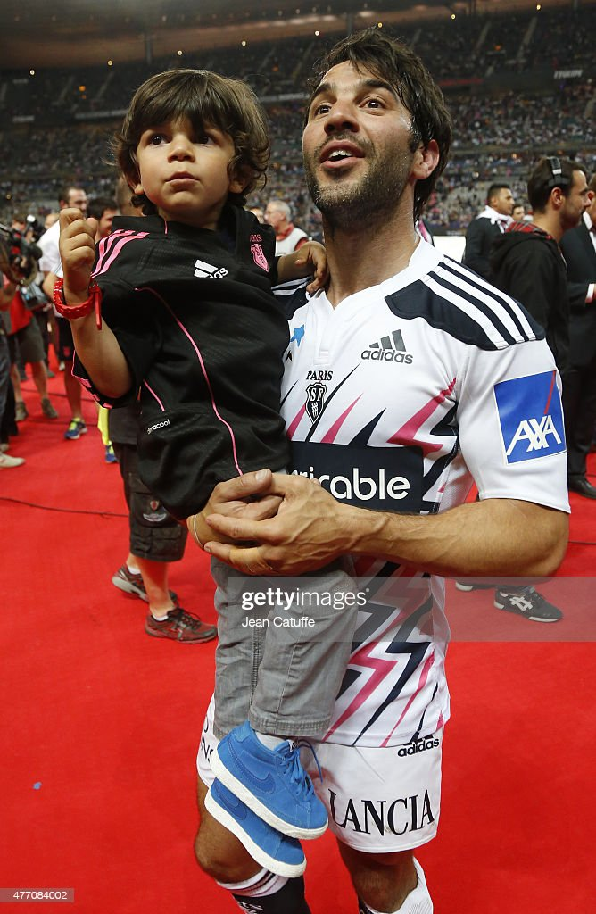 <a gi-track='captionPersonalityLinkClicked' href=/galleries/search?phrase=Jerome+Fillol&family=editorial&specificpeople=698636 ng-click='$event.stopPropagation()'>Jerome Fillol</a> of Stade Francais and his son celebrate winning the Bouclier de Brennus Trophy after the Top 14 Final between ASM Clermont Auvergne and Stade Francais Paris at Stade de France on June 13, 2015 in Saint-Denis nearby Paris, France.