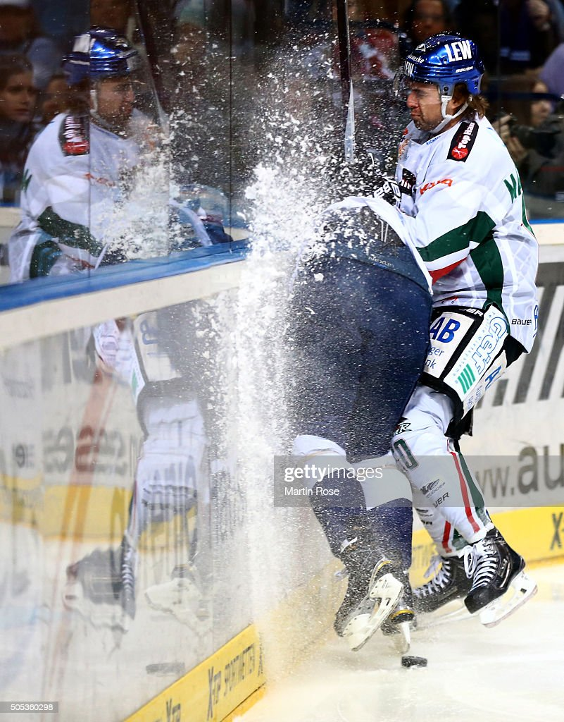 Jerome Flaak of Hamburg Freezers crashes into the boards with Jonathan Matsumoto #10 of Augsburger Panthers during the DEL game between Hamburg Freezers and Augsburger Panthers at at Barclaycard Arena on January 17, 2016 in Hamburg, Germany.