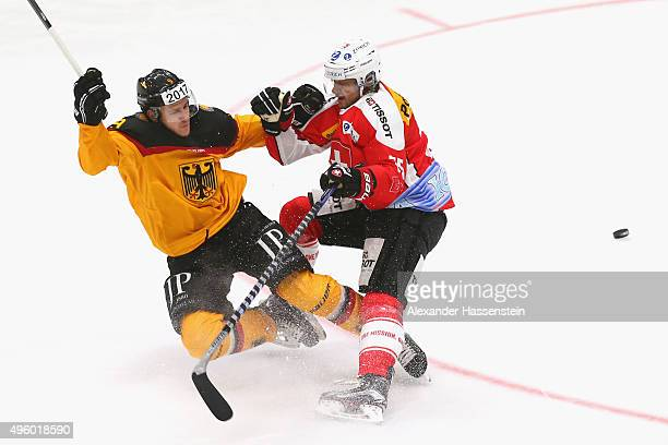 Jerome Flaake of Germany skates with Lukas Stoop of Switzerland during match 2 of the Deutschland Cup 2015 between Germany and Switzerland at...