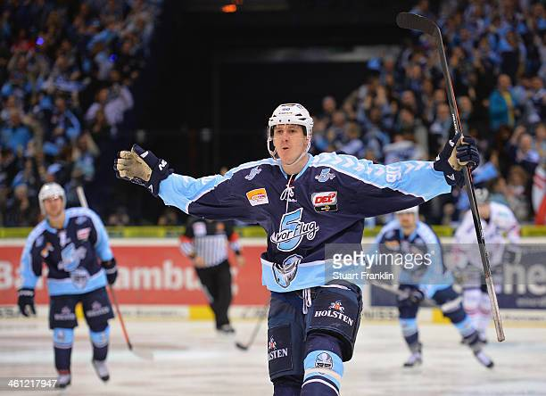 Jerome Flaake of Hamburg celebrates scoring his goal during the DEL ice hockey match between Hamburg Freezers and Eisbaeren Berlin at O2 World on...