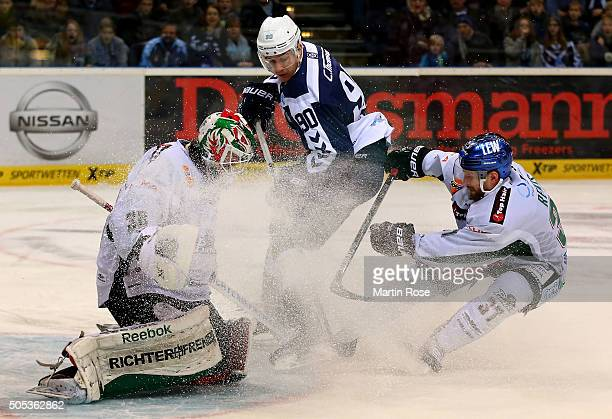 Jerome Flaake of Hamburg Freezers fails to score over Jeff DrouinDeslauriers goaltender of Augsburger Panthers during the DEL game between Hamburg...