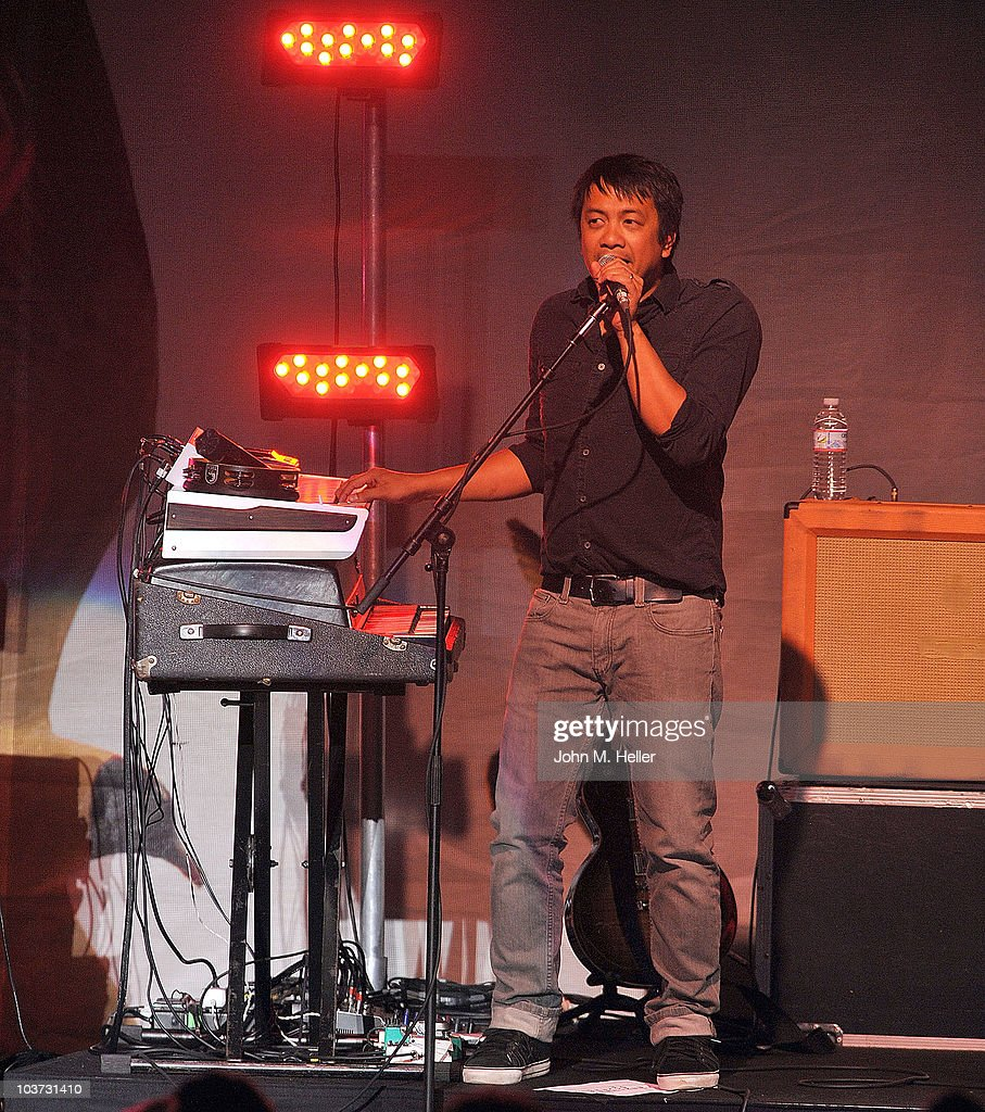 Jerome Fonramillas Keyboardist and backup guitar player of the group Switchfoot performs at the Greek Theater on August 29, 2010 in Los Angeles, California.