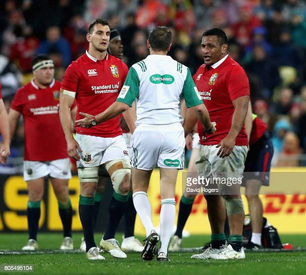 Jerome Garces the referee talks to Lions prop Mako Vunipola and Lions captain Sam Warburton during the match between the New Zealand All Blacks and...
