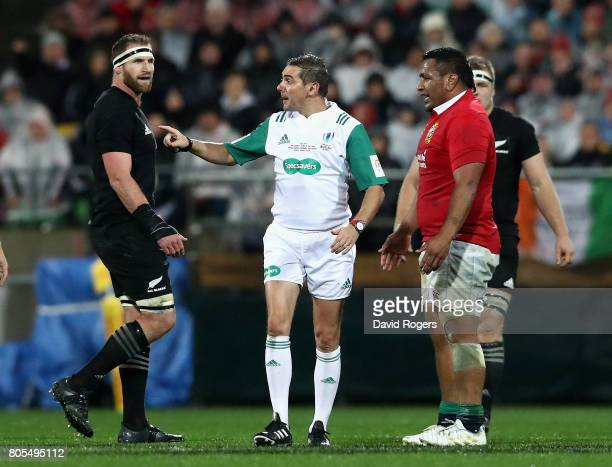 Jerome Garces the referee talks to Lions prop Mako Vunipola as All Black captain Kieran Read during the match between the New Zealand All Blacks and...