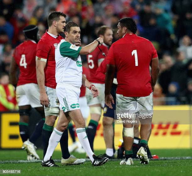 Jerome Garces the referee talks to Lions prop Mako Vunipola during the match between the New Zealand All Blacks and the British Irish Lions at...