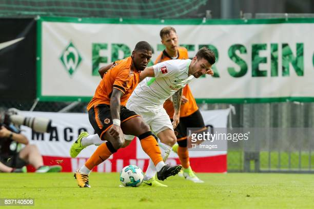 Jerome Gondorf of Bremen and Ivan Cavaleiro of Wolverhampton Wanderers battle for the ball during the preseason friendly between Werder Bremen and...