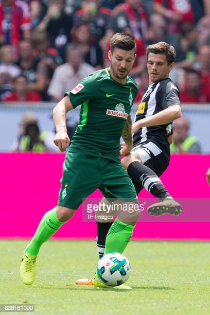 Jerome Gondorf of Bremen and Jonas Hofmann of Gladbach battle for the ball during the Telekom Cup 2017 match between Borussia Moenchengladbach and...