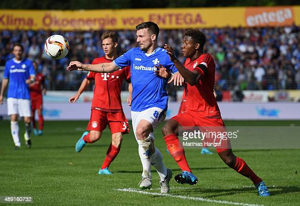 Jerome Gondorf of Darmstadt and David Alaba of Muenchen compete for the ball during the Bundesliga match between SV Darmstadt 98 and FC Bayern...