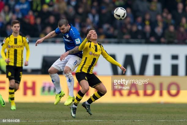 Jerome Gondorf of Darmstadt and Emre Mor of Dortmund battle for the ball during the Bundesliga match between SV Darmstadt 98 and Borussia Dortmund at...