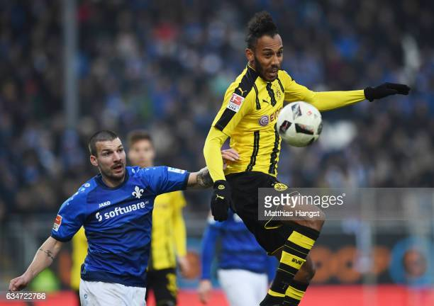 Jerome Gondorf of Darmstadt and PierreEmerick Aubameyang of Dortmund compete for the ball during the Bundesliga match between SV Darmstadt 98 and...