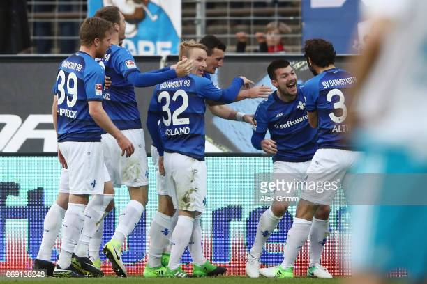 Jerome Gondorf of Darmstadt celebrates his team's second goal with team mates during the Bundesliga match between SV Darmstadt 98 and FC Schalke 04...