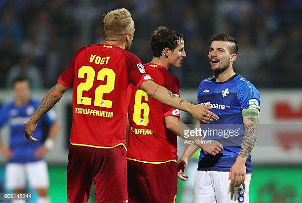 Jerome Gondorf of Darmstadt discusses with Sebastian Rudy and Kevin Voigt of Hoffenheim during the Bundesliga match between SV Darmstadt 98 and TSG...