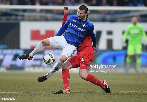Jerome Gondorf of Darmstadt is challenged by Frederik Sorensen of Koeln during the Bundesliga match between SV Darmstadt 98 and 1 FC Koeln at Stadion...