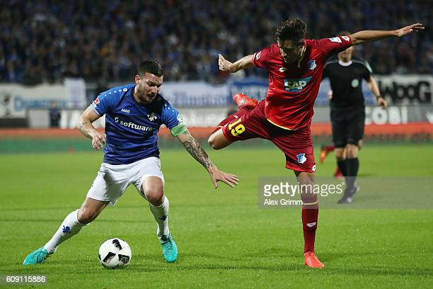 Jerome Gondorf of Darmstadt is challenged by Mark Uth of Hoffenheim during the Bundesliga match between SV Darmstadt 98 and TSG 1899 Hoffenheim at...