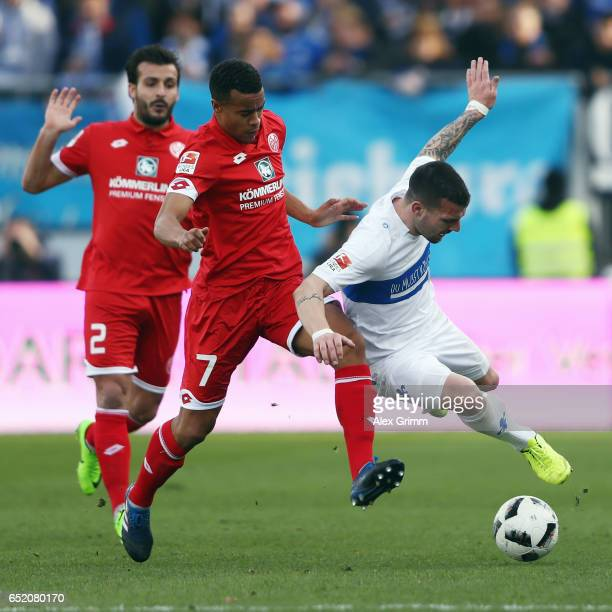 Jerome Gondorf of Darmstadt is challenged by Robin Quaison of Mainz during the Bundesliga match between SV Darmstadt 98 and 1 FSV Mainz 05 at...