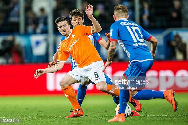Jerome Gondorf of Darmstadt is challenged by Tobias Strobl of Hoffenheim during the Bundesliga match between 1899 Hoffenheim and SV Darmstadt 98 at...