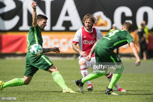 Jerome Gondorf of SV Werder Bremen Lasse Schone of Ajax Robert Bauer of SV Werder Bremen during the friendly match between Ajax Amsterdam and SV...