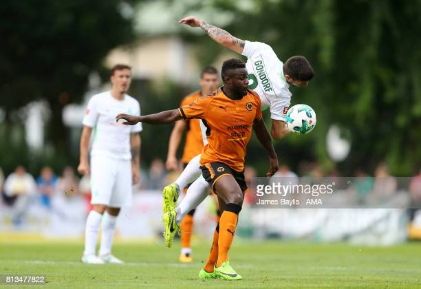 Jerome Gondorf of Werder Bremen and Bright Enobakhare of Wolverhampton Wanderers during the preseason friendly between Werder Bremen and...