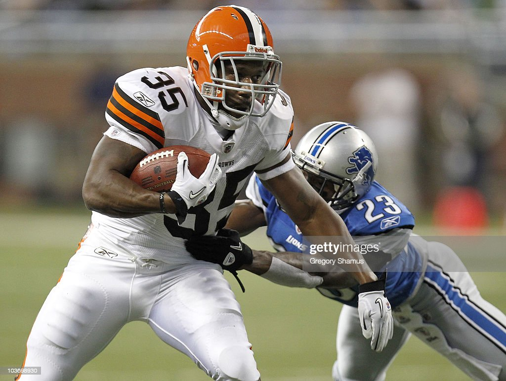 Jerome Harrison #35 of the Cleveland Browns tries to escape the tackle of Chris Houston #23 of the Detroit Lions during preseason game on August 28, 2010 at Ford Field in Detroit, Michigan.