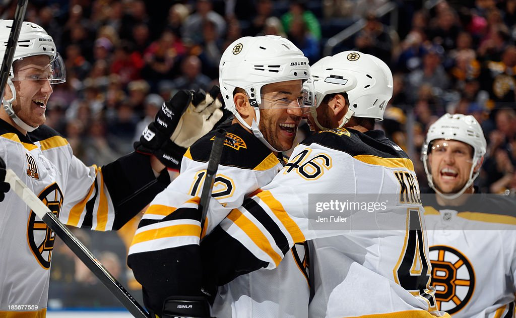 Jerome Iginla #12 of the Boston Bruins and teammate David Krejci #46 celebrate the goal of Milan Lucic #17 (not shown) against the Buffalo Sabres at First Niagara Center on October 23, 2013 in Buffalo, New York.