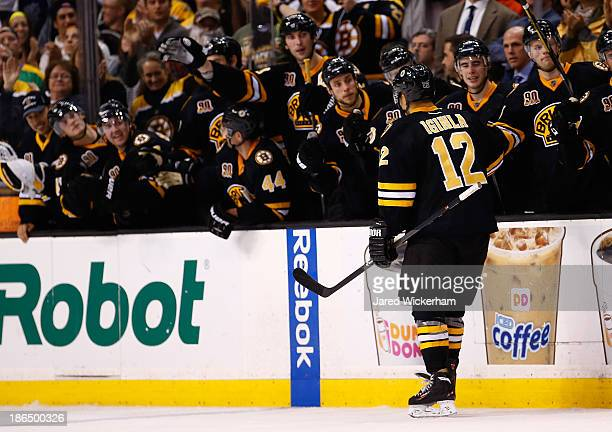 Jerome Iginla of the Boston Bruins is congratulated by his teammates after scoring in an overtime shootout against the Anaheim Ducks at TD Garden on...