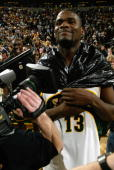 Jerome James of the Seattle SuperSonics dons a garbage bag in celebration after beating the Sacramento Kings 122118 in game five of the Western...