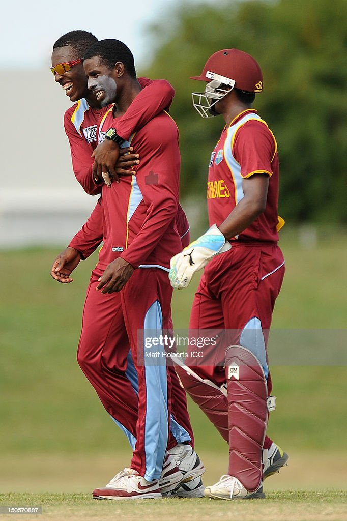 Jerome Jones (L) hugs Derone Davis of the West Indies during the ICC U19 Cricket World Cup 2012 Semi Final match between Pakistan and the West Indies at Endeavour Park on August 22, 2012 in Townsville, Australia.