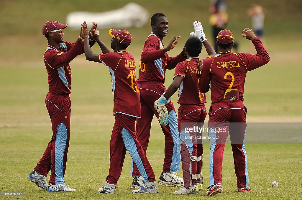 Jerome Jones (C) of the West Indies celebrates a wicket with team mates during the ICC U19 Cricket World Cup 2012 Semi Final match between Pakistan and the West Indies at Endeavour Park on August 22, 2012 in Townsville, Australia.