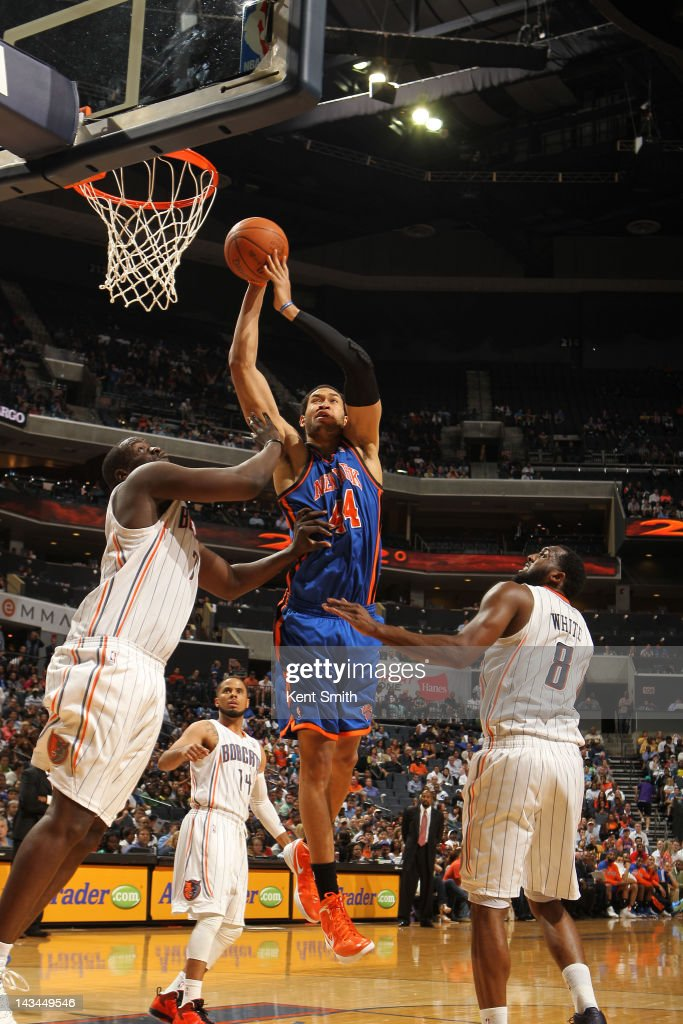Jerome Jordan #44 of the New York Knicks shoots against <a gi-track='captionPersonalityLinkClicked' href=/galleries/search?phrase=DeSagana+Diop&family=editorial&specificpeople=213233 ng-click='$event.stopPropagation()'>DeSagana Diop</a> #7 of the Charlotte Bobcats at the Time Warner Cable Arena on April 26, 2012 in Charlotte, North Carolina.