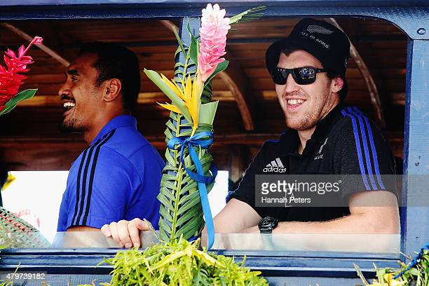 Jerome Kaino and Brodie Retallick of the New Zealand All Blacks enjoy a bus ride during a parade down the main street of Apia on July 7 2015 in Apia...