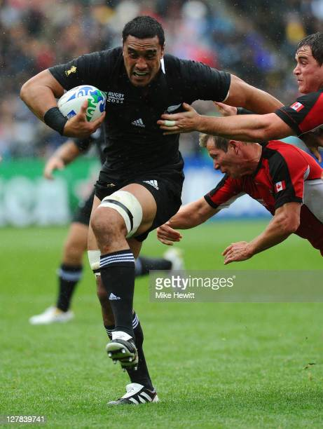 Jerome Kaino of the All Blacks breaks through the Canada to score his team's eighth try during the IRB Rugby World Cup Pool A match between New...