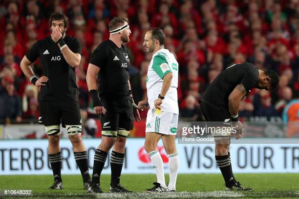 Jerome Kaino of the All Blacks is given a yellow card by referee Romain Poite Kieran Read and Sam Whitelock react during the Test match between the...